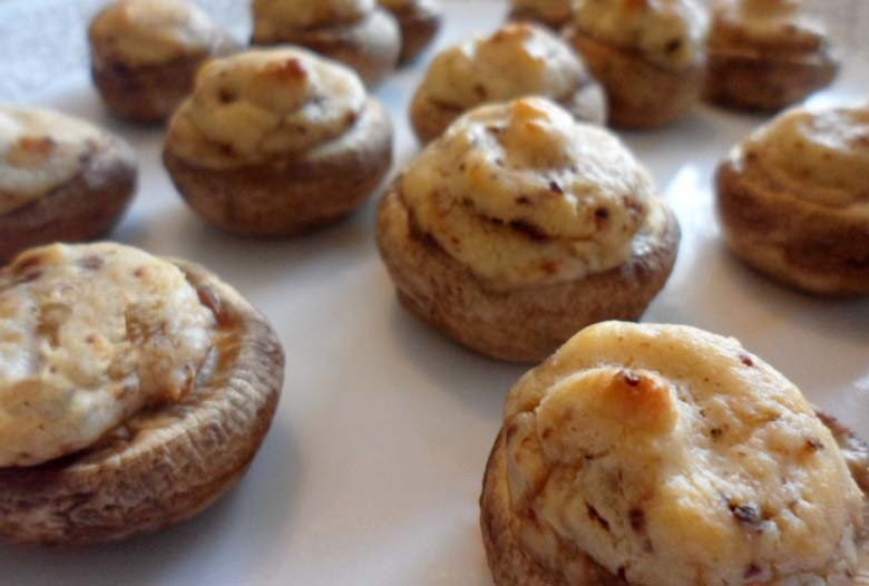 Cheesy stuffed mushroom caps are a divine Thanksgiving appetizer