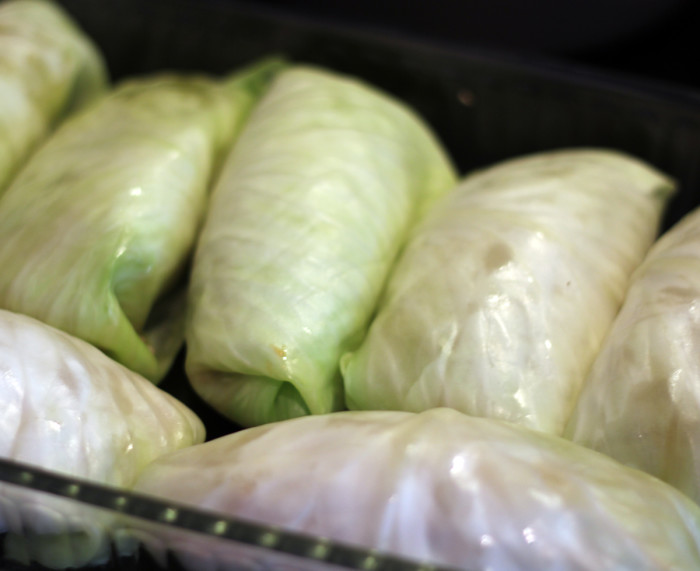 The cabbage rolls are filled and almost ready to go in the oven.