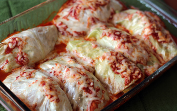 The cooked cabbage rolls coming out of the oven.